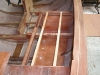 Plywood floors fitted over foam buoyancy in side lockers.