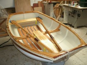 Completed boat with oars and buoyancy fitted