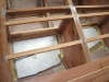 Polystyrene foam in flotation chambers under locker floor.
