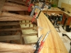 Strip planking edge nailed and clamped to frames