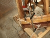"""Fitting strip planks to stem using Spanish Windlass, plywood """"U"""" clamps and wedges and steel G and F Clamps."""
